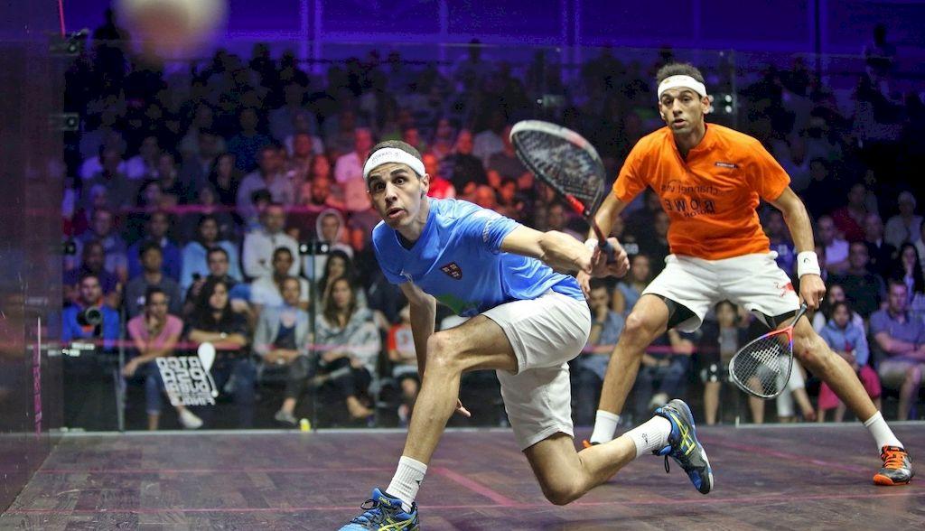 squash player kicks the ball